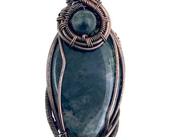 Moss Agate gemstone pendant with Heartenite, wire wrapped in copper. Releasing Long-Standing Patterns Of Emotional Reactivity