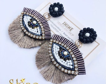 Embroidery handcrafted earrings evil eye