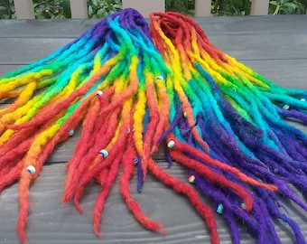 DE Rainbow wool dreads approx 36 inches from tip to tip (18 inches when folded in half) and are made to order