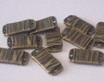 In-between 10 metal bronze 15 x 7 x 2 mm