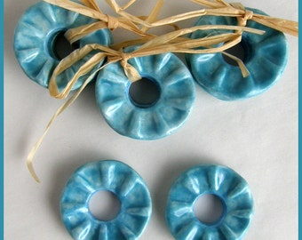 Turquoise ceramic ruffled donuts