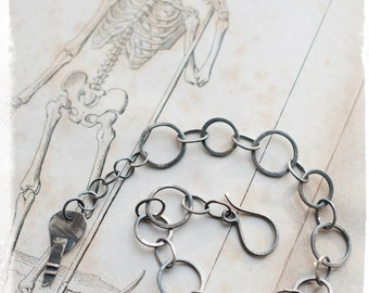 Sterling silver forged link bracelet with key charm, lucky talisman for new beginnings and unlocking opportunity.
