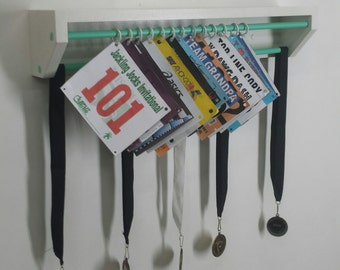 Trendy Running display for race bibs and medals-White and aqua. race bibs display, race bibs holder, medal and bib holder, medal holder