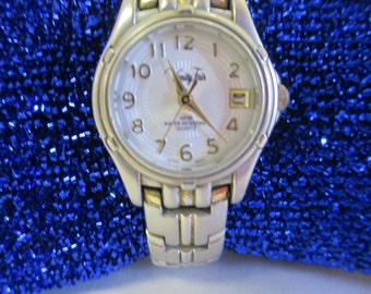"""Vintage jewelry Ladies watch, """" Vanity Fair""""   silver tone band with snap closure used fair condition"""