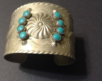 Silver tone and faux turquoise cuff bracelet, Native American inspired, with etched Native American symbols.