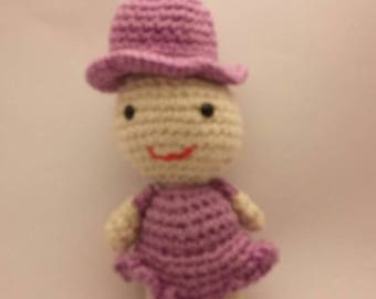 small crocheted doll
