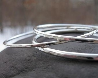 thin sterling silver bangles . ((Weesa Bangles)) . set of 3 bangles with hammered edges in varied thicknesses . made to order in your size
