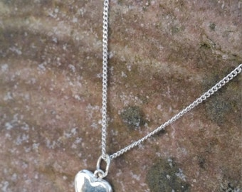 Solid silver hearts. Four different sizes. Engraved or stamped letter.