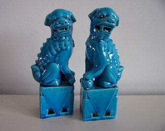 A pair of Chinese  turquoise Foo-dogs