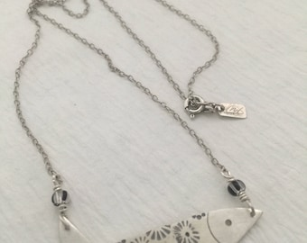 coral flower stamped sterling silver fish necklace on etched sterling silver cable chain with black striped glass beads