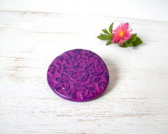 Purple fuchsia brooch -floral embossed circular, polymer clay pin