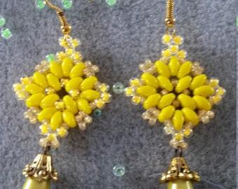 a beautiful pair of earrings manda yellow