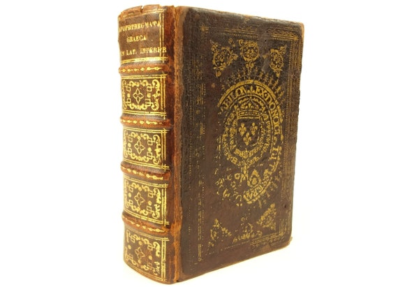 1568 Apophthegmata, Plutarch, Diogenes Laertio, etc. Latin and Greek parallel text. Armorial binding. Provenance. 1st edition. Estienne.