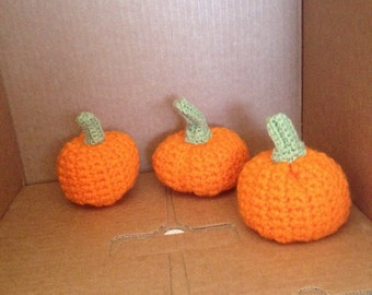 Homemade Crochet pumpkins. Approximately 3X2.5 inches.