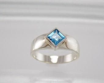 Silver Bezel Set Ring w/ Swiss Blue Topaz Square Center Stone