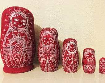 Red Russian dolls, matryoshka nesting dolls, wooden dolls in dolls, babushka home decor