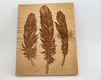 3 Feathers Carved Sign