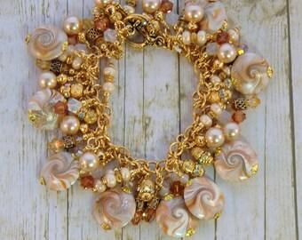 SALE! Caramel tan and gold charm bracelet, swarovski topaz pearl and rhinestone bracelet boho gypsy polymer swirl beaded bracelet, dangles