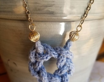 Baby blue Celtic knot crocheted necklace on silver chain