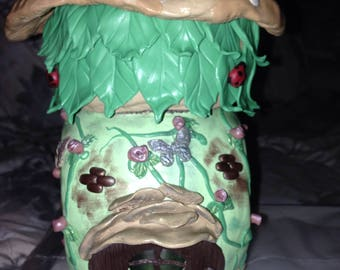 Polymer clay decorated fairy house