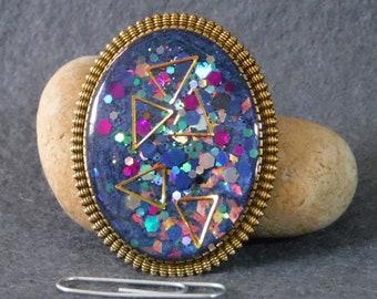Resin brooch, blue shimmery glitter