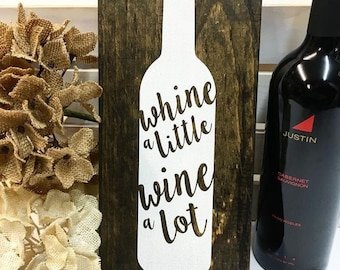 Whine a little whine a lot wood sign