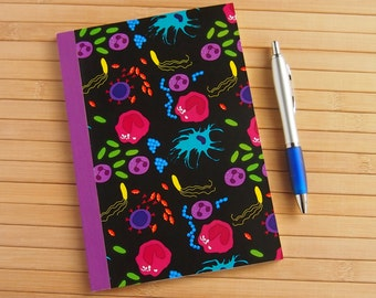Science notebook / sketchbook with immune cells and bacteria
