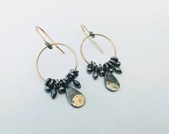 Handmade gold and oxidized silver hook earrings with gold accent.