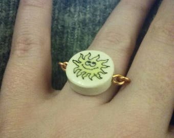 Copper ring and ceramic Sun pattern