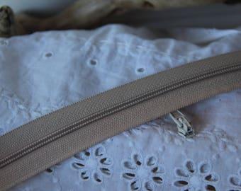 Set of 5 sliders N 4 white broken zipper