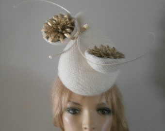 ivory textured wool perching hat infused with gold threads,sculptured leather flowers & a brace of curled quills