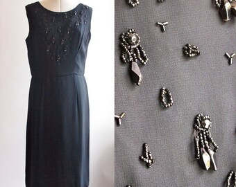 1960's black cocktail dress with beaded detail on front, size 20 (hips 44)
