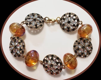 Amber and gold tone disc bracelet
