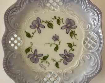 Handpainted purple violets on a decorative coaster plate