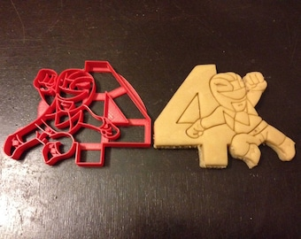 Power Rangers Cookie Cutter next to the number 4. Perfect for your kid's 4th year birthday party. Celebrate their fourth with the rangers!