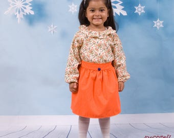 Girls skirt in orange cotton with blue heart button