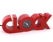 Red plastic 1980s CLOCK shaped CLOCK (mains powered, alarm)