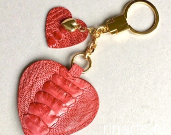 Heart keychain / Heart bag charm made from red genuine ostrich leather, with a luxe gold keyring and gold heart charm. Luxury gift for her