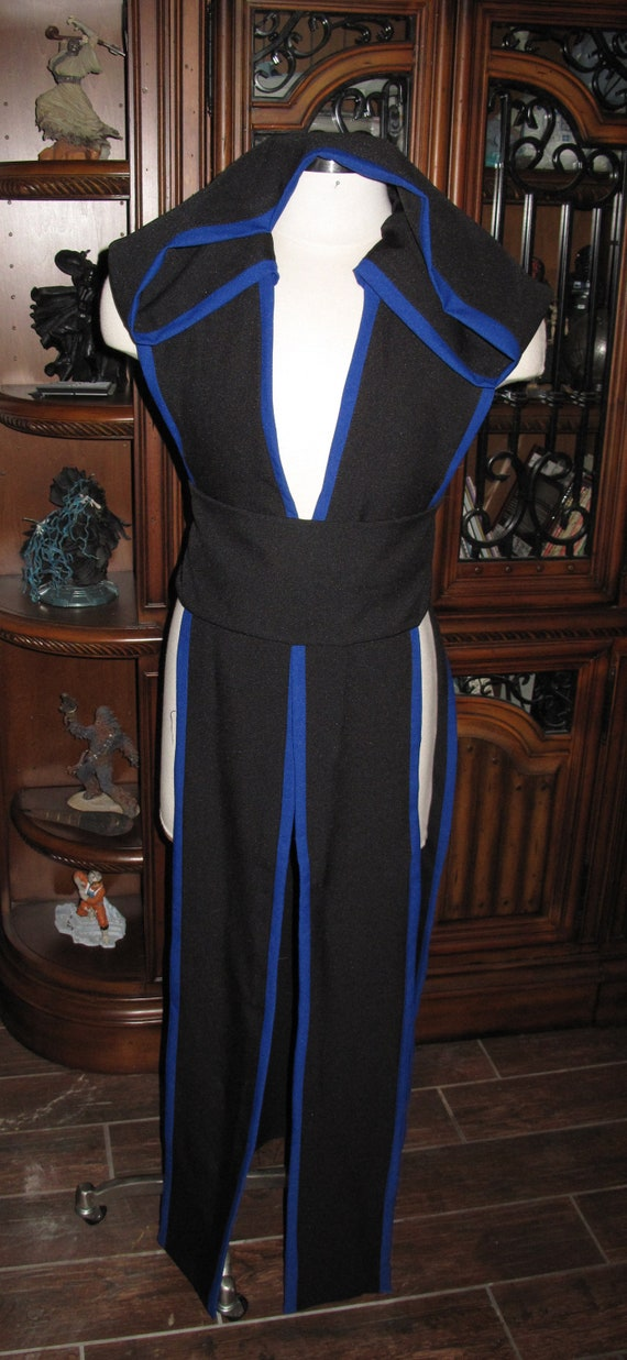 Black sleeveless hooded floor length tabard vest with blue border and sash in several sizes