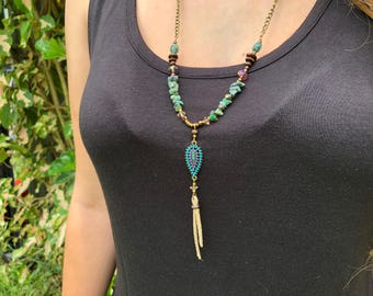 Turquoise necklace with embellished pendant