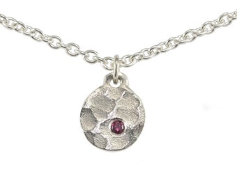 WINTER LAKE Necklace with Natural Ruby - hammered & textured round disc pendant