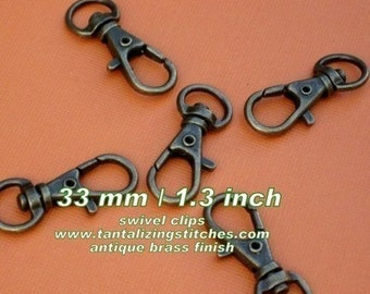34mm / 1.3 Inch Swivel Clips in Antique Brass Finish - choose from 230, 595, and 1500 pieces