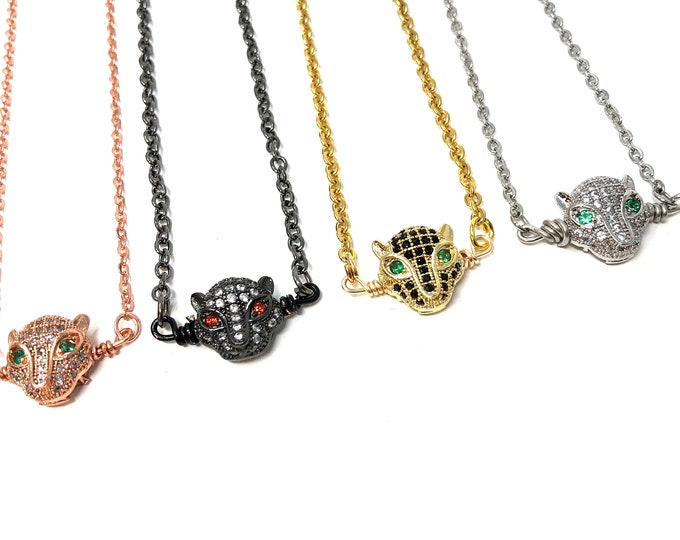 PANTHER: panther pave necklaces in rose gold, gunmetal, gold, and silver