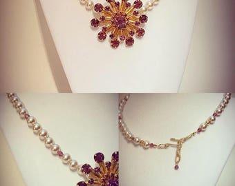 Purple crystal brooch, faux pearl necklace