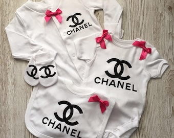 Cute designer inspired baby gift set with hot pink  bows ( inclues a sleepsuit,bodysuit,bib and scratch mitts) 0-3 or 3-6 months
