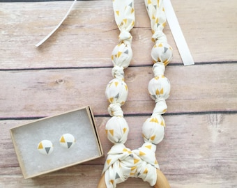 Yellow Pennant Fabric Teething Ring Necklace by Wee Kings