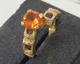 9 ct solid gold dress ring with an orange center stone