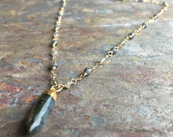 Labradorite and iolite gemstone gold necklace with a labradorite spike pendant