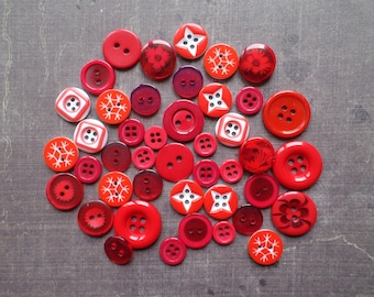 40 buttons round mix of size pattern colour red