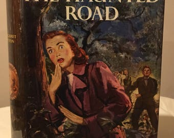 Judy Bolton - The Haunted Road by Margaret Sutton in Dust Jacket